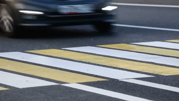 A man crossing the highway at the crosswalk