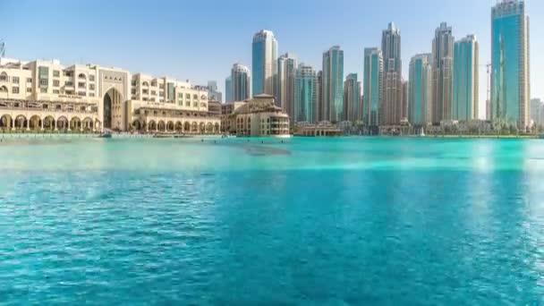 Timelapse of Dubai fountain near Dubai Mall on a sunny day