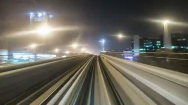 Train is approaching and enters into metro station in Dubai is a city and emirate in United Arab Emirates
