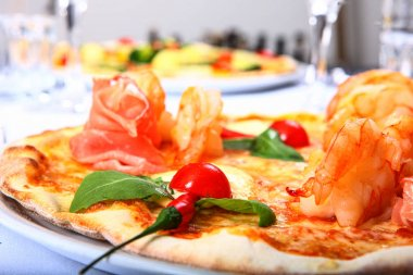 Pizza with tomato, meat and pineapple toppings