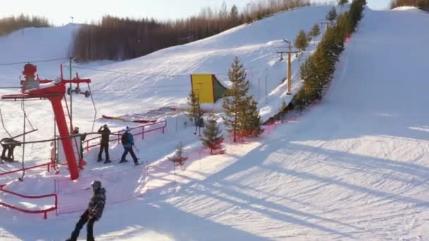 snowboarder rides on a mountainside on a winter day, top view
