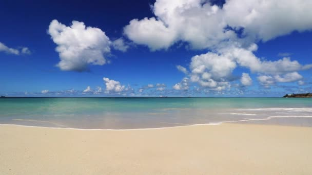 Beach, waves and clouds of the idyllic beach of St. Johns, Antigua and Barbuda, a country located in the West Indies in the Caribbean Sea