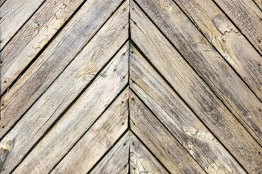 Wooden unpainted boards. Herringbone. Close-up. Background. Text