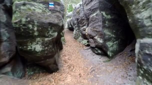 Walk in narrow path in sand rocks corridor like in labyrinth.