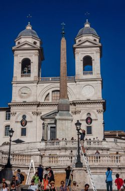ROME, ITALY - SEPTEMBER 8, 2008: Electritian fixes street lamp in front of Santissima Trinita dei Monti church at the top of Spanish Steps near Piazza di Spagna in Rome, Italy on September 8, 2008
