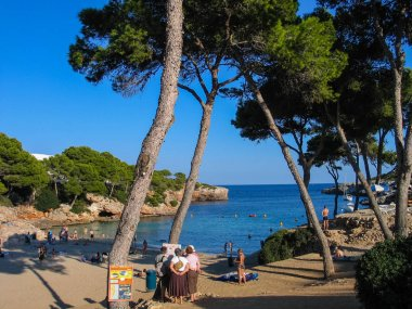 MAJORCA, SPAIN - SEPTEMBER 9, 2007: People attend beach at Cala Esmeralda bay in Majorca, Spain on September 9, 2007