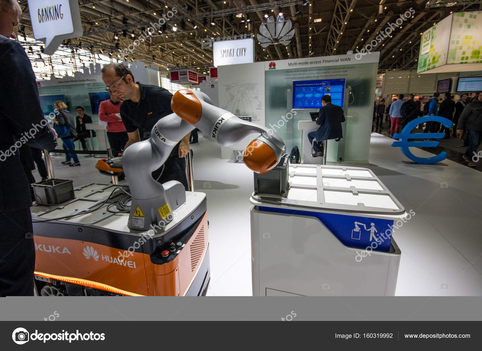 HANNOVER, GERMANY - MARCH 14, 2016: Engineer operates