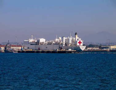 SAN DIEGO, CALIFORNIA, US - MARCH 16, 2007: Naval hospital ship Mercy at San Diego bay. Mercy is converted San Clemente-class supertanker now used by the United States Navy as naval ambulances. It contains 12 fully-equipped operating theaters