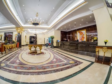 MOSCOW, RUSSIA - APRIL 18, 2018: Ritz Carlton hotel lobby and reception desk in Moscow, Russia on April 18, 2018. Hotel was built in 2007 in eclecticism style on site of the former Intourist hotel