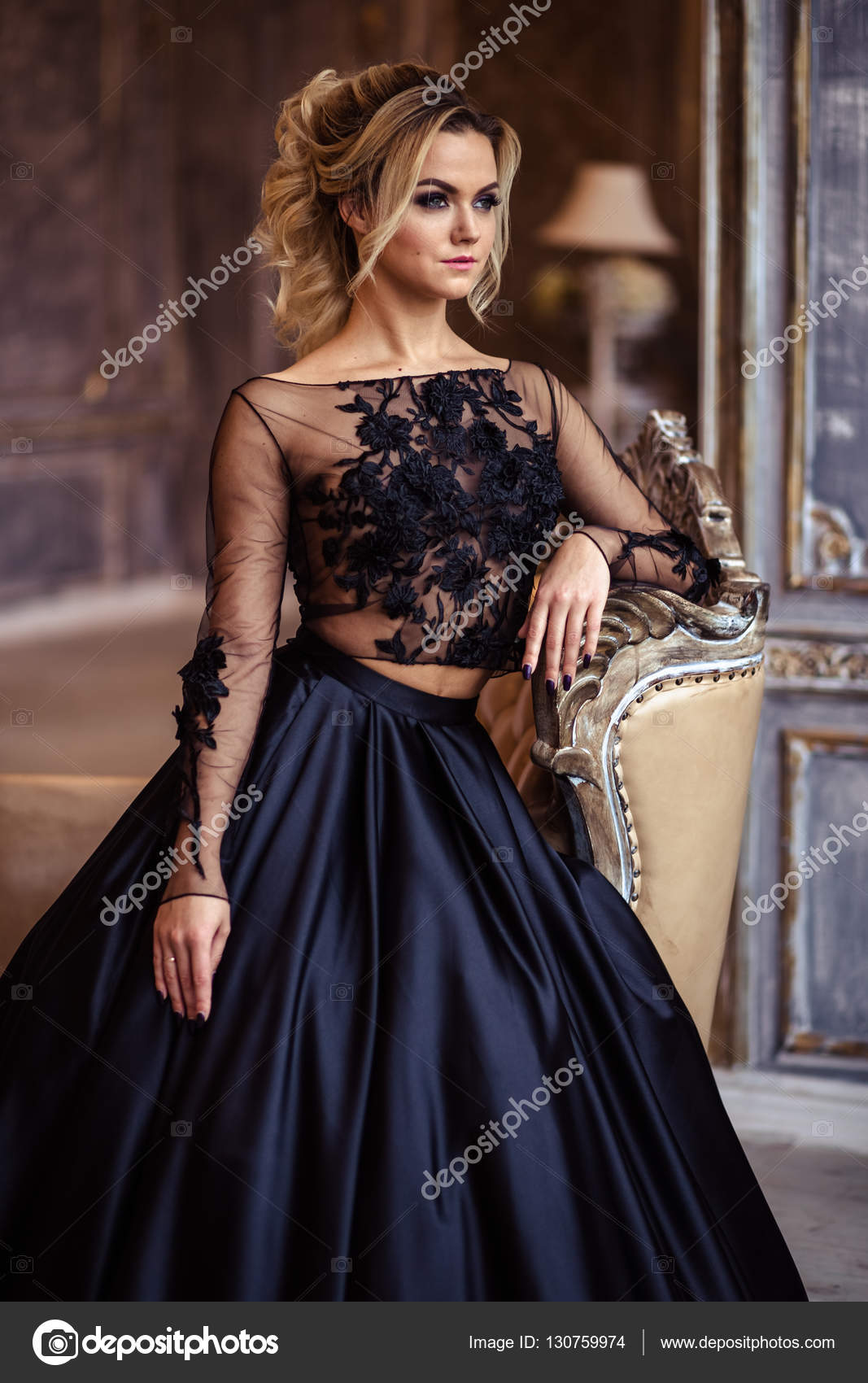 Beautiful young woman in gorgeous black evening dress with perfect ...