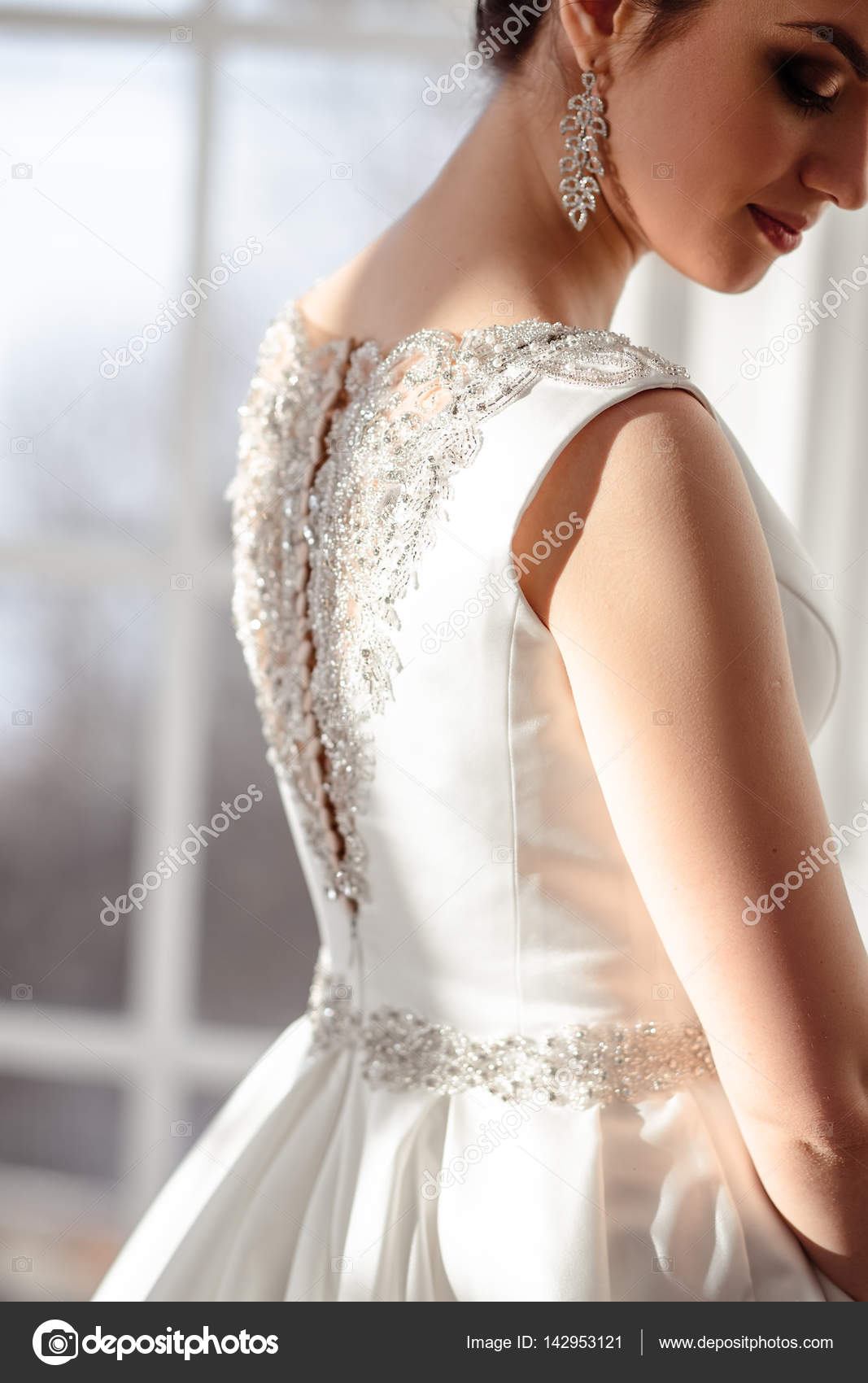close-up portrait of beautiful brunette bride with elegant hairstyle ...