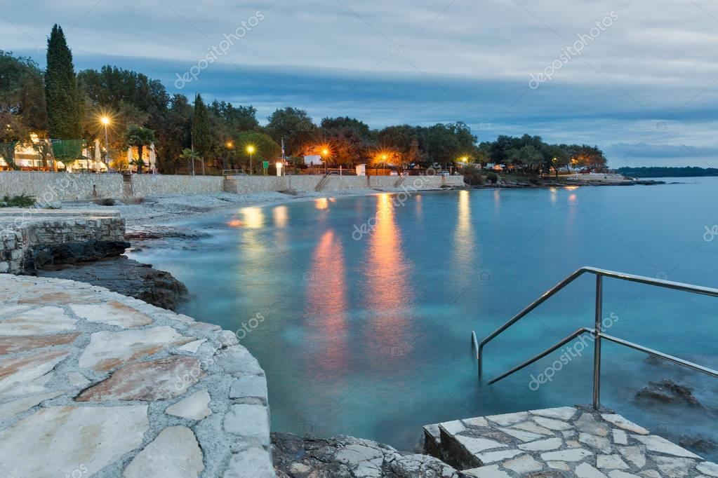 Mediterranean sumer resort with Adriatic sea beach at evening