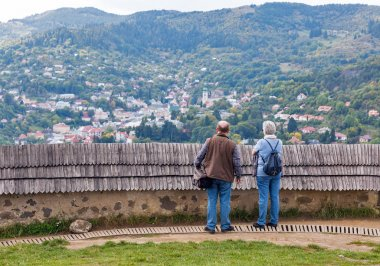 Tourists admire the view from Calvary in Banska Stiavnica, Slovakia.