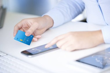 businesswoman holding bank card