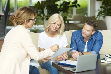 couple consulting with real estate agent