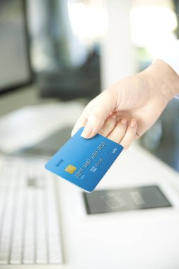 businesswoman  holding credit card in her hand.