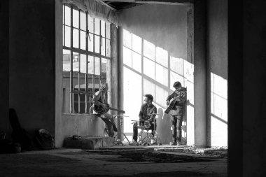 ock band members playing music