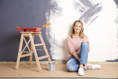 smiling middle aged woman painting