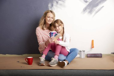 girl and her mother sitting