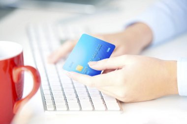 woman holding bank card