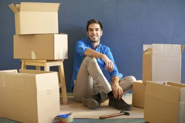 happy young man sitting at  his home