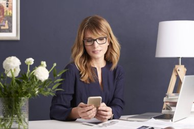 businesswoman using her cellpone