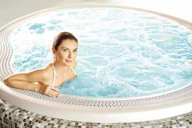 woman sitting at hot tub