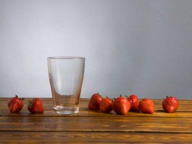 Empty glass for yogurt or smoothie in glass on wooden table