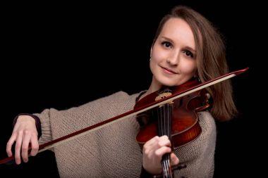 Wonderful violinist staring at camera