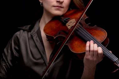 Classical music concept with unrecognizable violinist