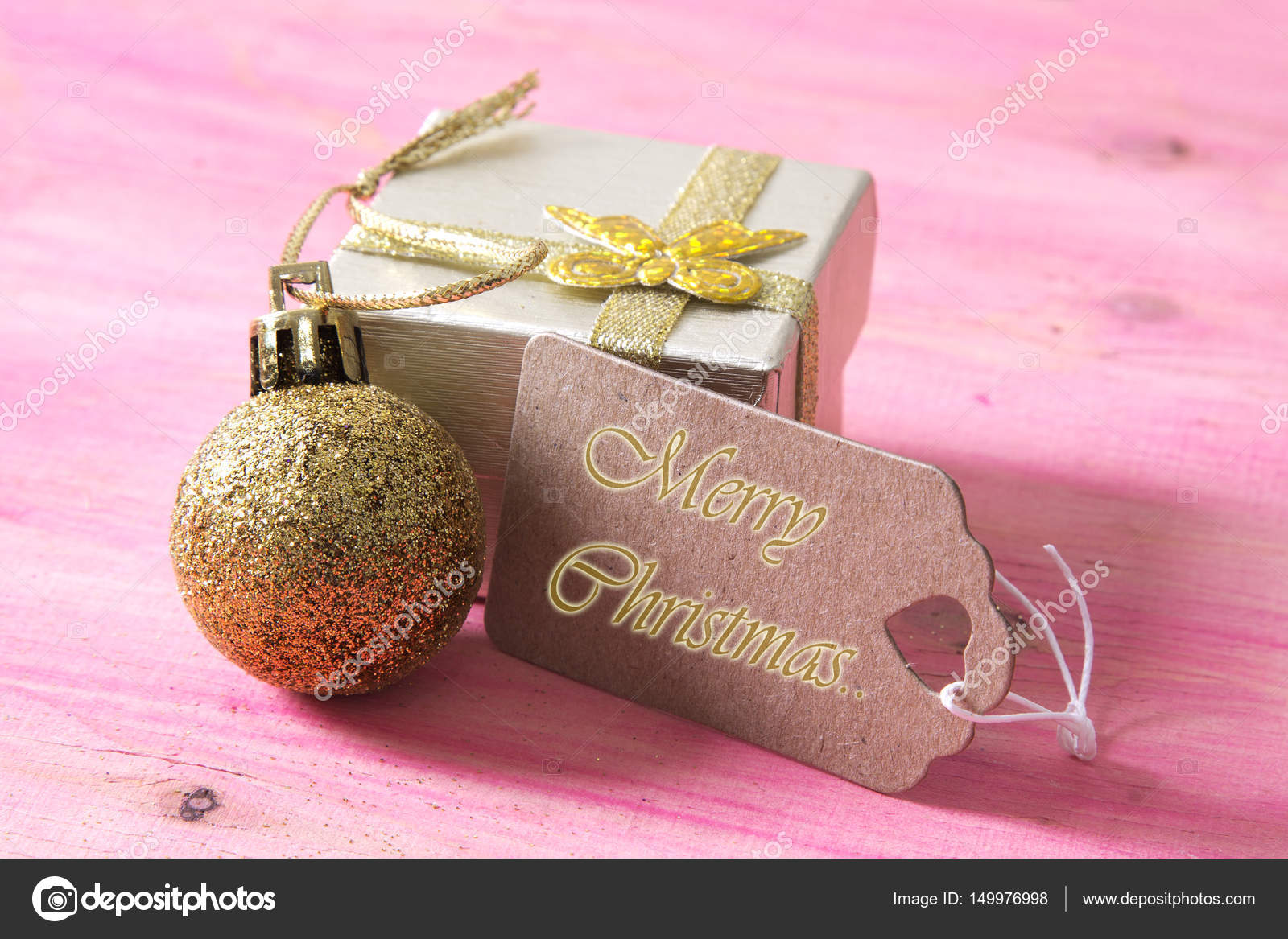 happy new year card with gift box and tag on pink wooden bakckground ...