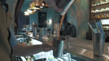 Barman making cocktail drink