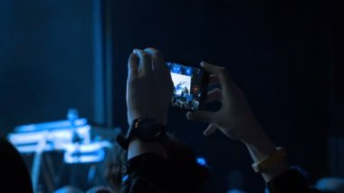 Human making video of concert