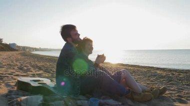 couple on Beach with guitar