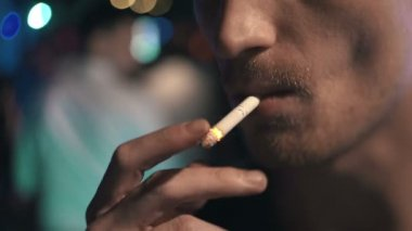 Male smoking cigarette
