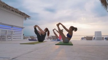 Fitness group doing Yoga