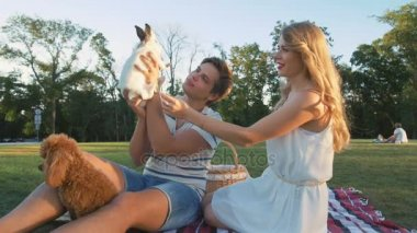 couple with dog and rabbit