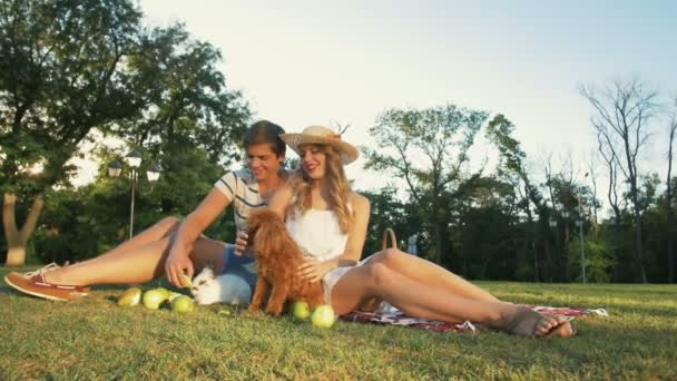 young couple with dog and rabbit