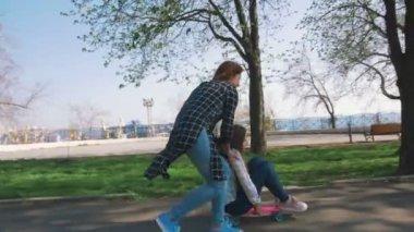 girls riding board at park