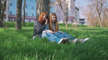 girls on grass listening music