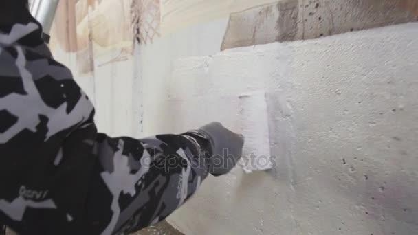 man drawing graffiti