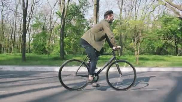 man riding on fixed gear bike