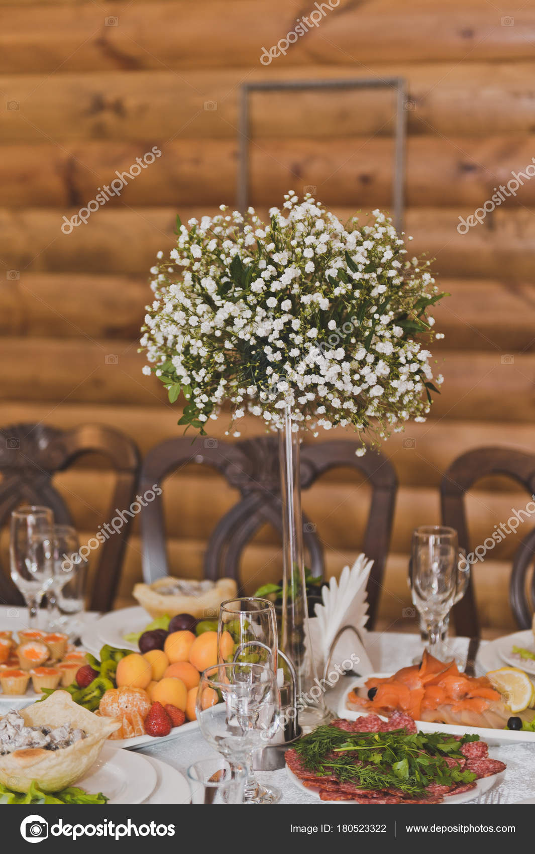 Beautiful bouquet of small white flowers on the table among frui beautiful bouquet of small white flowers on the table among frui stock photo izmirmasajfo