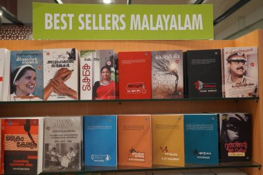 A set of Malayalam novels displayed in a book store. A shelf full of old and new Malayalam books - Kochi, Kerala: 18 February 2020