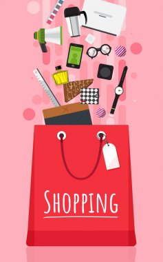 Shopping bag with fashion items, gadgets and clothes on pink background