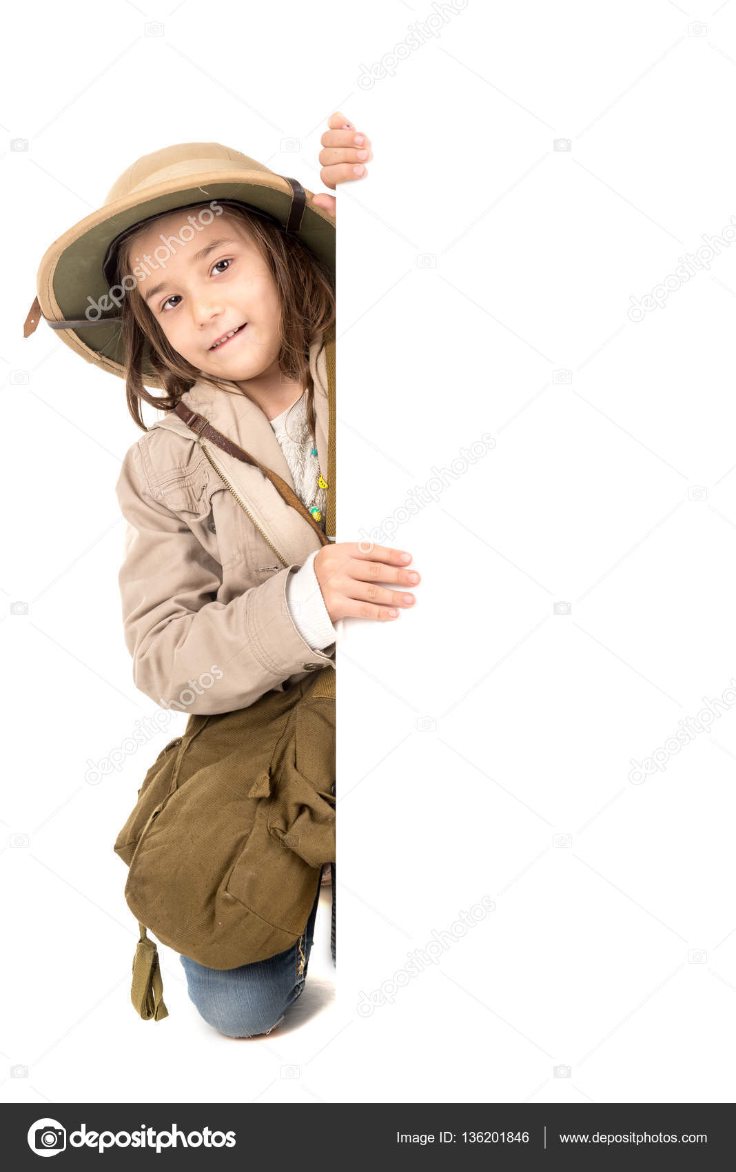 5a64871ca047f Young girl with Safari clothes behind a white board isolated in white —  Photo by ...