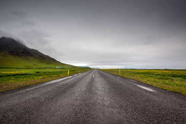 Empty road with cloudy skies in wild Iceland stock vector