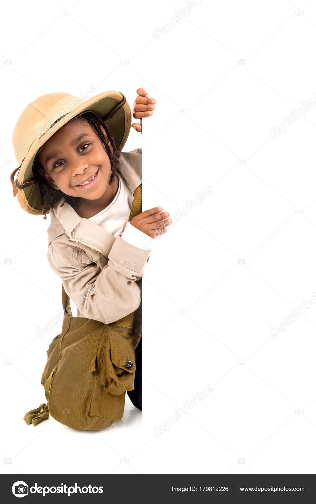 f4da9986fdcc9 Young girl with Safari clothes behind a white board isolated in white —  Photo by luislouro