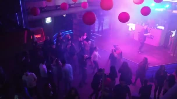 Kiev, Ukraine, Europe - January 26, 2020: Disco in the night club Forsage.  Party in the night club Forsage (Fast and the Furious). People on the dance floor in the club. Light spotlights in a nig
