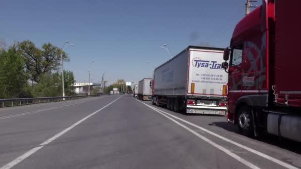 Europe, state border Ukraine - Slovakia, customs post in Tisa, May 2020: Truck at the customs post during the Covid-19 coronavirus pandemic. Trucker crosses the border. Closed borders. Buried border